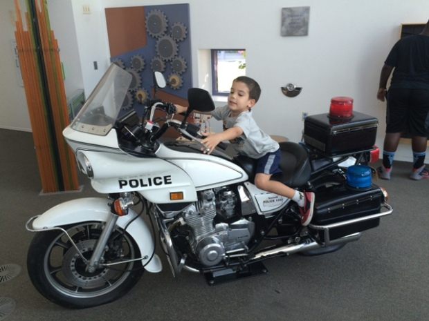 An actual police motorcycle is there for the kids to crawl all over.